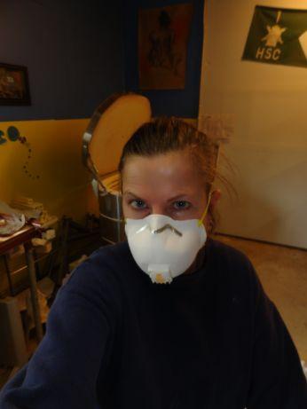 Sherry wearing dust mask